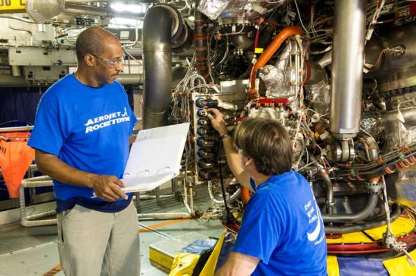 Aerojet Rocketdyne technicians inspect the new controller on the RS-25 development engine, E0528