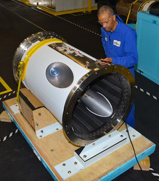 The Orion jettison motor for Artemis 1 is prepped for shipment by an Aerojet Rocketdyne engineering technician at the company's facility in Orange, Virginia