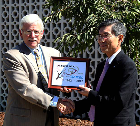 Michael Bright of Aerojet and Dr. Kazuo Katayama of Daicel honor 50 years of company partnership.