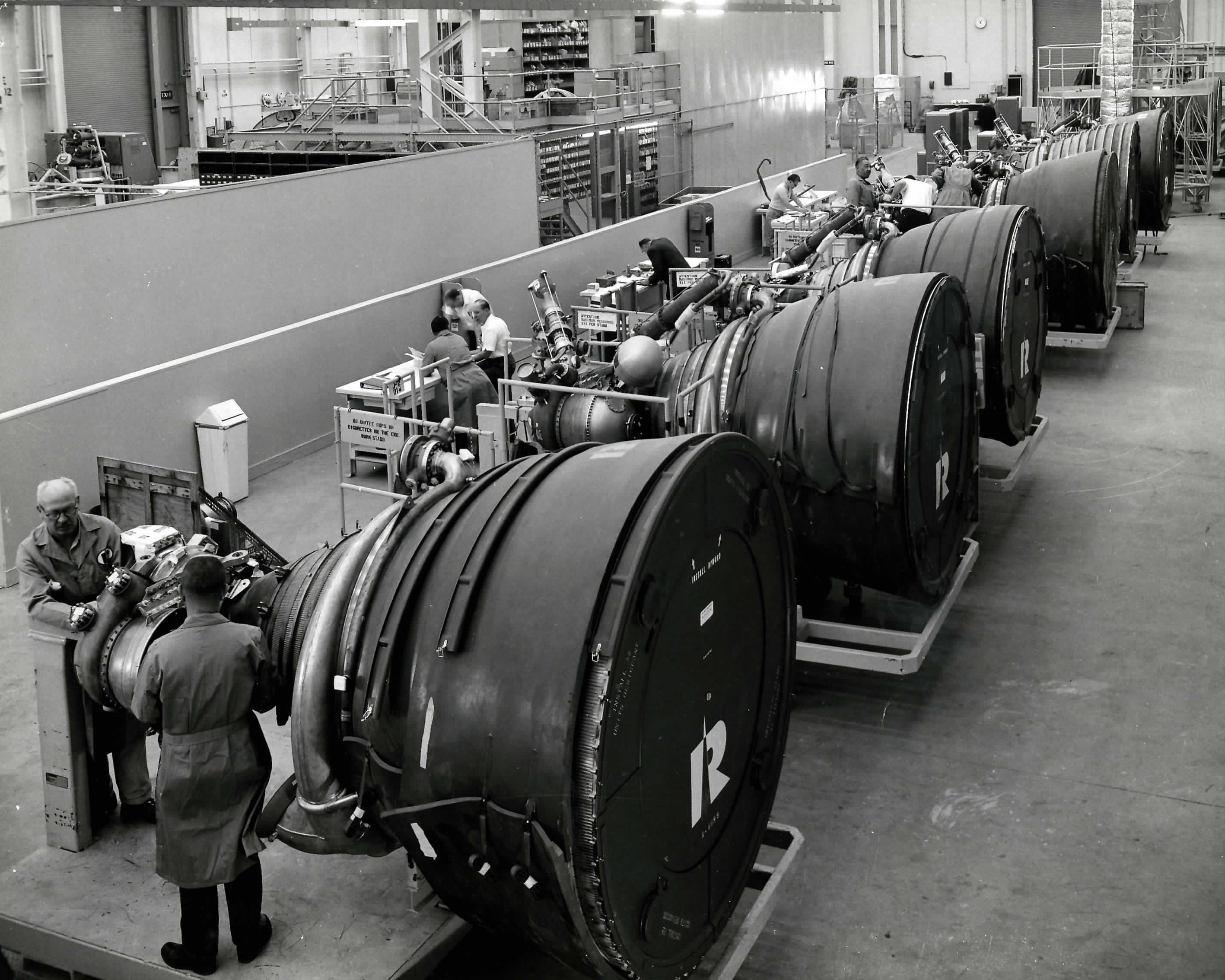 J-2 Assembly Line in Canoga Park – Archive photo of the J-2 assembly line at Aerojet Rocketdyne's Canoga Park facility. Six hydrogen-fueled J-2 rocket engines were used on the Saturn V to take humans to the moon.
