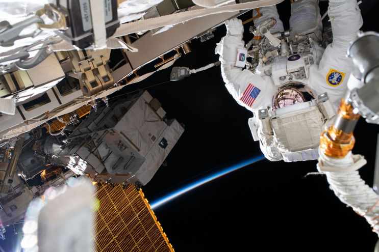 NASA astronaut Chris Cassidy works during a six-hour spacewalk to install three lithium-ion batteries on the International Space Station's truss structure. Credit: NASA