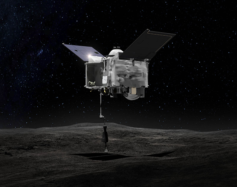 OSIRIS-REx contacts the asteroid Bennu with the Touch-And-Go Sample Arm Mechanism or TAGSAM. Credit: NASA