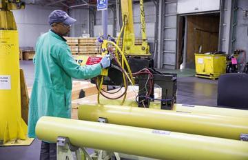 An Aerojet Rocketdyne Camden employee prepares a solid rocket motor for shipment