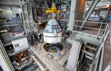 Nov. 21, 2019 - The Boeing CST-100 Starliner spacecraft is guided into position above a ULA Atlas V rocket at the Vertical Integration Facility, Space Launch Complex 41, Florida's Cape Canaveral Air Force Station. Credits: NASA/Cory Huston
