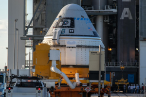 Nov. 21, 2019 - A transporter carrying the Boeing CST-100 Starliner spacecraft arrives at the Vertical Integration Facility, Space Launch Complex 41, Cape Canaveral Air Force Station, Florida. Credits: NASA/Kim Shiflett